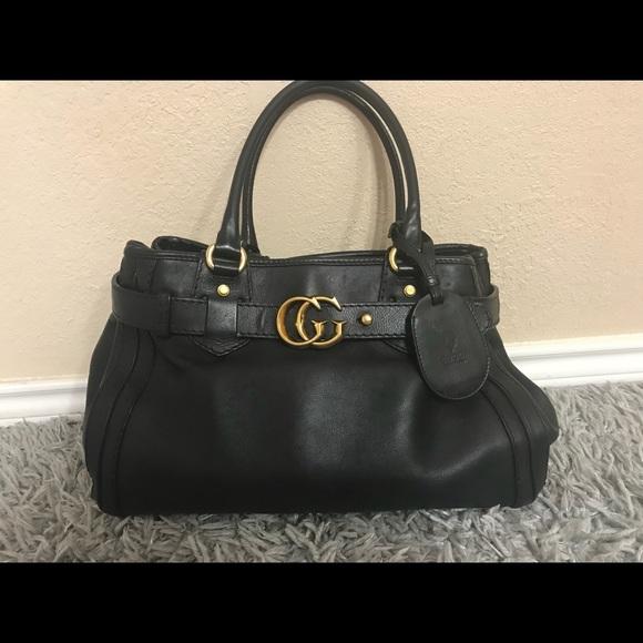 987daeca72d Gucci Handbags - Gucci Black Leather GG Running Medium Tote